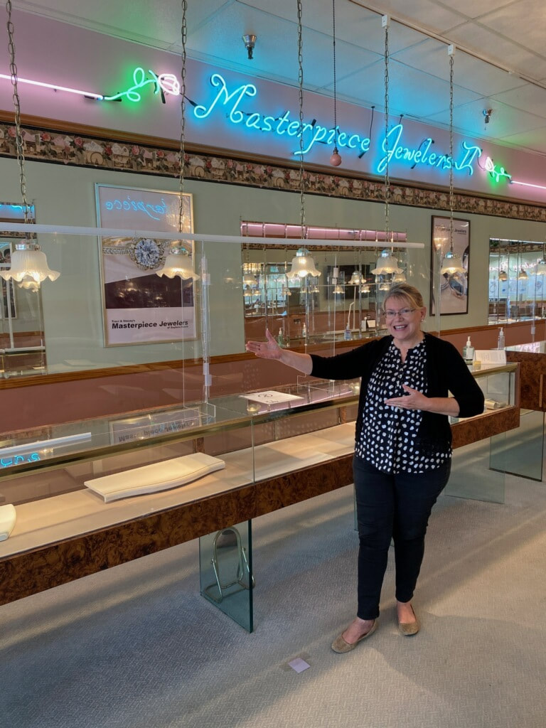 Tracy shows off the new Lucite safety barriers at your family jewelry store, Masterpiece Jewelers.